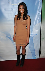 Meaghan paired her nude cutout dress with black leather mid calf boots for an unconventional red carpet look.