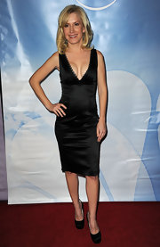 Angela Kinsey was a knockout in black satin platforms. The pumps were the perfect choice for her sultry cocktail dress.