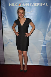 Piper Perabo paired a charcoal body-con dress with matching suede pumps adorned with crystals.