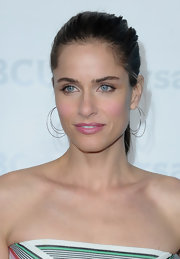 Amanda Peet wore her long hair in a simple sleek ponytail while attending the NBC Universal 2012 Winter TCA Tour All Star Party.