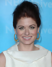 Debra Messing wore her auburn locks in a voluminous French twist while attending the NBC Universal 2012 Winter TCA Press Tour All Star Party.