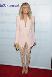 Nicole Richie showed off a fully modern look at the NBC Universal Winter TCA Press Tour in a pale pink blazer and leather-and-crystal pants.