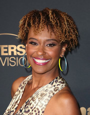 Ryan Michelle Bathe attended the NBC and Universal Emmy nominee celebration wearing her hair in short, tight curls.
