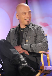 Howie Mandel achieved an edgy look by layering a patterned gray button-down over a black shirt.