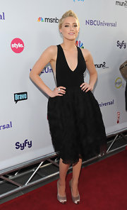 Amber Heard opted for a flirty black frock for the NBC All-Star party. She finished off the look with a pave cocktail ring.