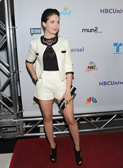 Alison Brie teamed a black tube clutch with her short suit and ankle boots when she attended the 2011 TCA press tour all-star party.