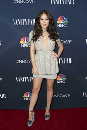 Kelli Berglund showed major cleavage in a beaded gray peplum dress with a deep-V neckline while attending NBC and Vanity Fair's toast to the 2016-2017 TV season.