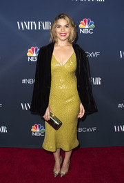 America Ferrera styled her outfit with elegant gold evening pumps.