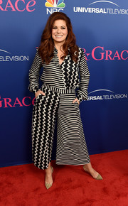 Debra Messing punctuated her outfit with a pair of nude suede and PVC pumps.
