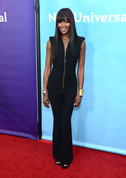 Naomi Campbell was statuesque in this black streamlined gown with a gold zipper.