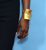 Naomi Campbell accessorized her evening look with a bold, woven gold cuff.