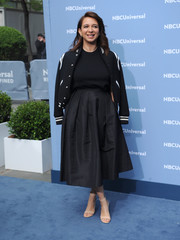 Maya Rudolph's black-and-white varsity jacket added a youthful touch.