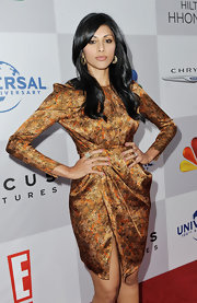 Reshma Shetty dazzled in a futuristic bronze cocktail dress at the Golden Globes viewing and after-party.