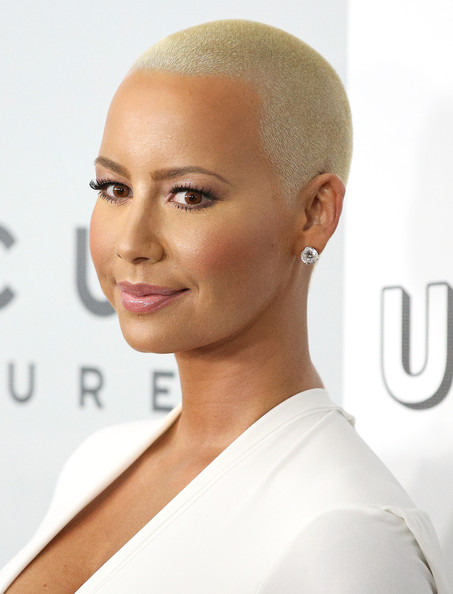 Amber Rose attended the NBCUniversal Golden Globes after-party wearing her trademark blonde buzzcut.
