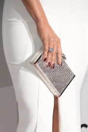 Jennifer Lopez accessorized her elegant white gown with a sparkling silver box clutch at the 2016 Golden Globes after parties.