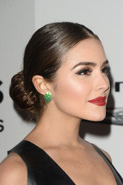 Olivia Culpo opted for a classic center-parted bun when she attended the NBCUniversal Golden Globes after-party.
