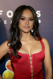 Karrueche Tran attended the NBCUniversal Golden Globes after-party wearing her hair in loose center-parted curls.