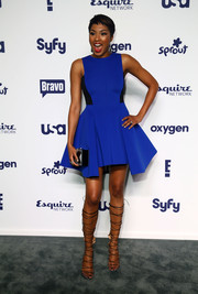 Alicia Quarles looked very fashion forward in an electric blue fit-and-flare mini by DKNY, featuring a high-low hem and black side panels, during the NBCUniversal Cable Entertainment Upfronts.