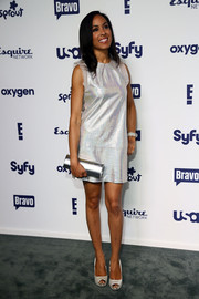 Brie Bythewood kept the shimmer going with a metallic silver clutch.