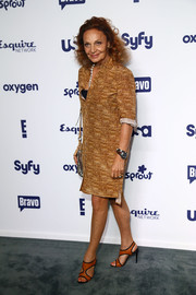 Diane von Furstenberg attended the NBCUniversal Cable Entertainment Upfronts wearing a tan shirtdress featuring a cork-like print.