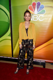 Nicole Richie layered a loose yellow House of Harlow 1960 x Revolve blouse over a black lace bodysuit for the NBCUniversal Press Junket.