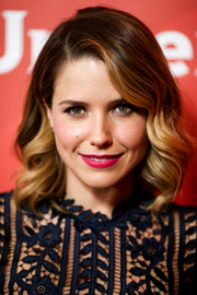 Sophia Bush sealed off her look with a vibrant pink lip.