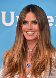 Heidi Klum framed her face with a center-parted layered cut for the 2018 NBCUniversal Summer Press Day.