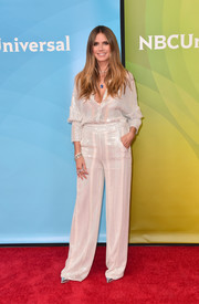 Heidi Klum was all about relaxed glamour in a sequined white tunic by Sally LaPointe at the 2018 NBCUniversal Summer Press Day.
