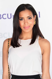 Julissa Bermudez wore her hair in a sleek subtly layered style while attending NBCUniversal Summer Press Day.