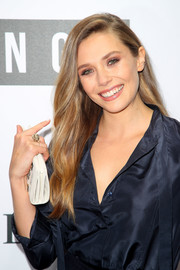 Elizabeth Olsen attended the NGV Gala wearing a chic cocktail ring.