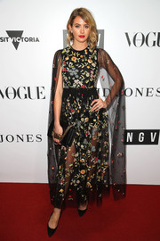 Jesinta Franklin finished off her outfit with a black chain-strap bag, also by Dior.