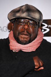 Cedric the Entertainer kept warm with a patterned pink scarf.
