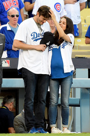 Mila Kunis twinned with her hubby in matching Dodgers baseball shirts for game 4 of the NLCS.