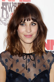 Alexa Chung gave her lids retro-inspired sweeps of black liquid liner for the 2012 NME Awards.
