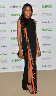 Naomie Harris chose a black and gold teardrop clutch to pair with her gown.