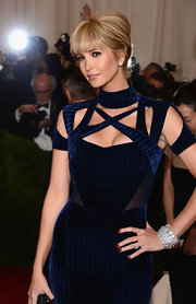 Ivanka swept her hair back into a classic French twist and styled her lash-grazing bangs sleek and straight.