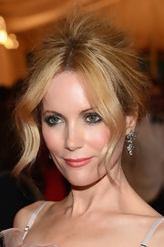 Leslie Mann wore her hair in a backcombed updo with long face-framing tendrils while attending the Met Gala.