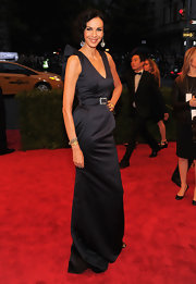 The buckle and pocket detailing on L'Wren Scott's navy evening gown were simple yet elegant.