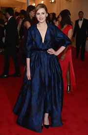 Laure Carmichael was one step ahead of the brocade trend in this glam midnight blue gown at the Met Gala.