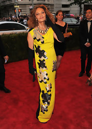 Diane Von Furstenberg put the pieces together in this yellow sequined puzzle dress on the Met red carpet.