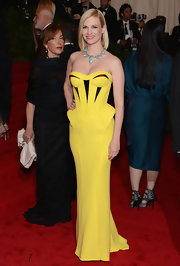Leave it to January Jones to wear a smoking Versace gown to the Met Gala.