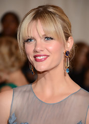 Brooklyn Decker arrived at the Costume Institute Gala wearing her long locks in a simple updo with long wispy bangs.