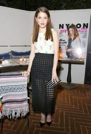Anna Kendrick topped off her multi-patterned look with a black and silver striped box clutch by Edie Parker.