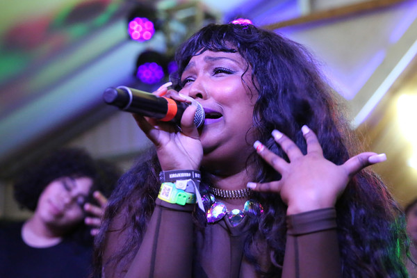More Pics of Lizzo Long Curls with Bangs (1 of 17) - Lizzo Lookbook - StyleBistro [the hulu original the handmaids tale celebrate sxstyle,performance,entertainment,singing,music artist,singer,performing arts,music,musician,song,event,lizzo,nylon,austin,texas,bar 96,twitterhouse]