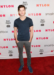 Cameron Monaghan attended the Nylon Magazine 13th Anniversary Celebration in a gray distressed T-shirt.