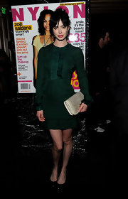 Krysten Ritter looked radiant in her emerald green dress. She paired her long-sleeve frock with a textured beige clutch.
