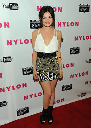 Lucy Hale toughened her red carpet look with black peep-toe mid-calf boots.