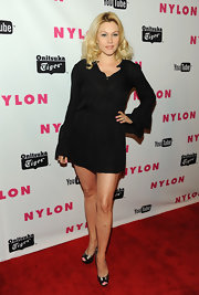 Shanna Moakler hit 'Nylon' magazine's Young Hollywood celebration in metallic gold and black platform peep-toes.