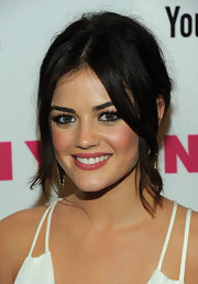 Lucy Hale completed her stunning look with a loose updo that featured face framing center part bangs.