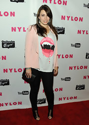 Sophie Simmons teamed up her graphic tee with a pink blazer.